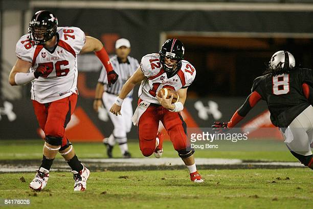 Quarterback Richard Brehaut of the white team looks for room to run behind offenssive lineman Kevin Graf while avoiding a sack attempt by defensive...