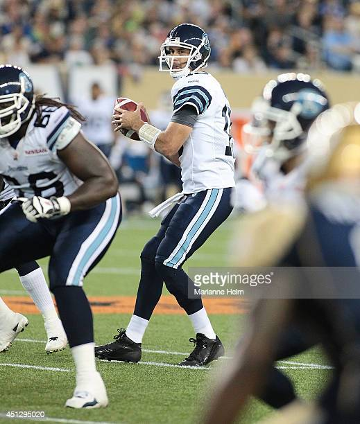 Quarterback Ricky Ray of the Toronto Argonauts looks to his target in second half action in a CFL game against the Winnipeg Blue Bombers at Investors...