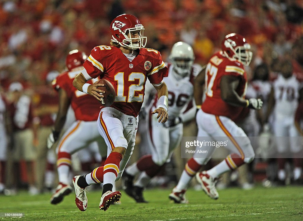 Quarterback <a gi-track='captionPersonalityLinkClicked' href=/galleries/search?phrase=Ricky+Stanzi&family=editorial&specificpeople=4483561 ng-click='$event.stopPropagation()'>Ricky Stanzi</a> #12 of the Kansas City Chiefs scrambles up field against the Arizona Cardinals during the second half on August 10, 2012 at Arrowhead Stadium in Kansas City, Missouri. Kansas City defeated Arizona 27-17.