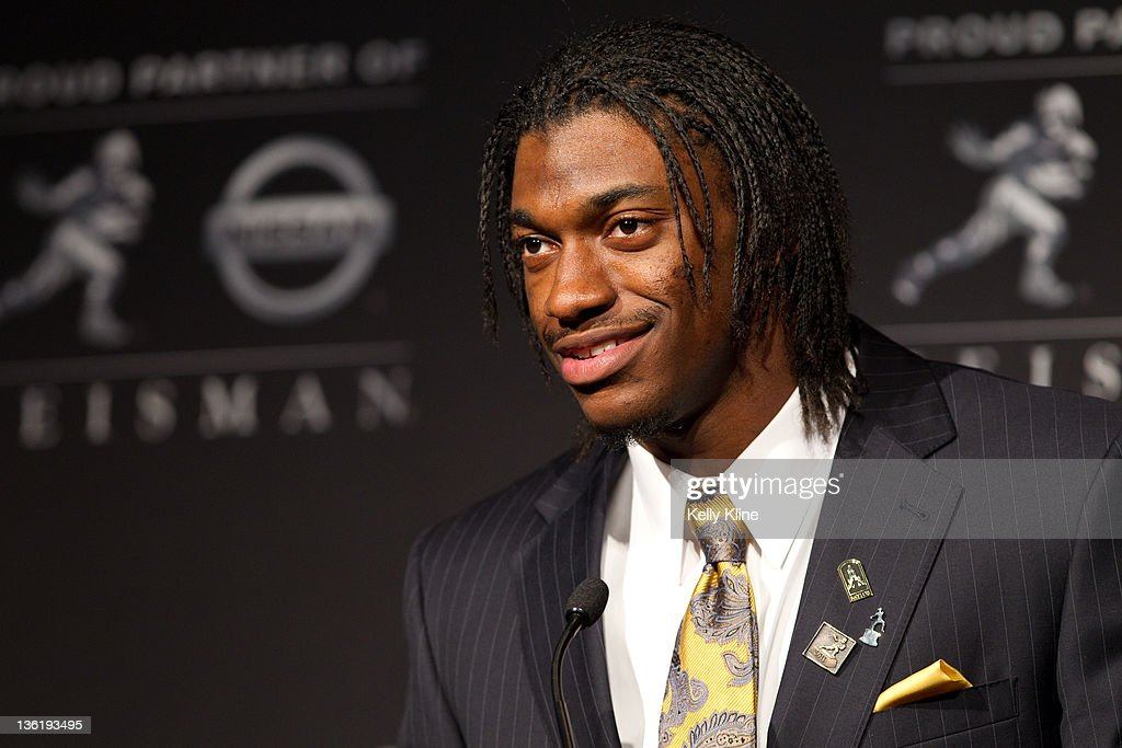 Quarterback Robert Griffin III of the Baylor Bears speaks to the media after being named the 77th Heisman Memorial Trophy Award winner at the Marriott Marquis on December 10, 2011 in New York City.