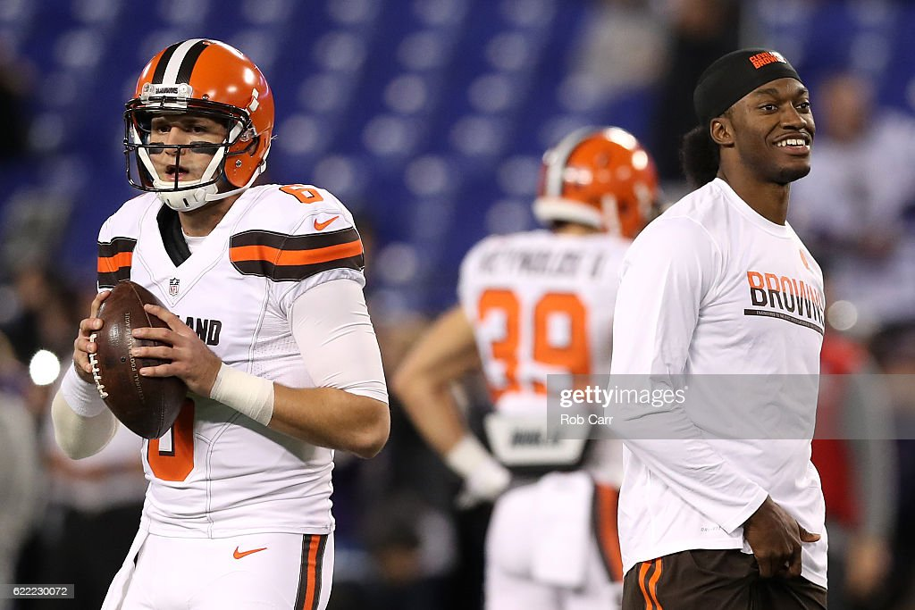 Quarterback Robert Griffin III #10 of the Cleveland Browns looks on while teammate quarterback Cody Kessler #6 warms up prior to a game against the Baltimore Ravens at M&T Bank Stadium on November 10, 2016 in Baltimore, Maryland.