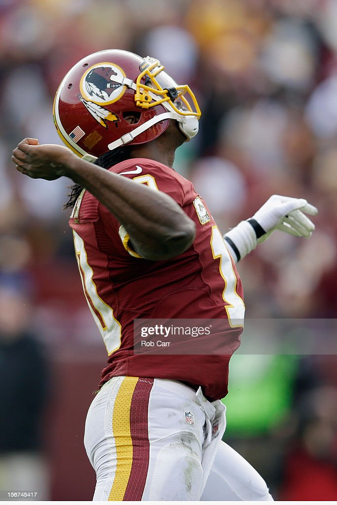 Quarterback <a gi-track='captionPersonalityLinkClicked' href=/galleries/search?phrase=Robert+Griffin&family=editorial&specificpeople=2495030 ng-click='$event.stopPropagation()'>Robert Griffin</a> III #10 of the Washington Redskins celebrates after throwing a second half touchdown pass against the Philadelphia Eagles at FedEx Field on November 18, 2012 in Washington, DC.