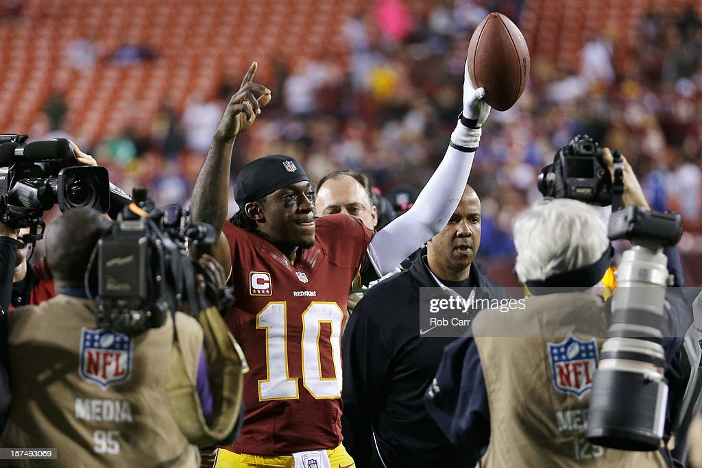 Quarterback <a gi-track='captionPersonalityLinkClicked' href=/galleries/search?phrase=Robert+Griffin&family=editorial&specificpeople=2495030 ng-click='$event.stopPropagation()'>Robert Griffin</a> III #10 of the Washington Redskins celebrates after the Redskins defeated the New York Giants 17-16 at FedExField on December 3, 2012 in Landover, Maryland.