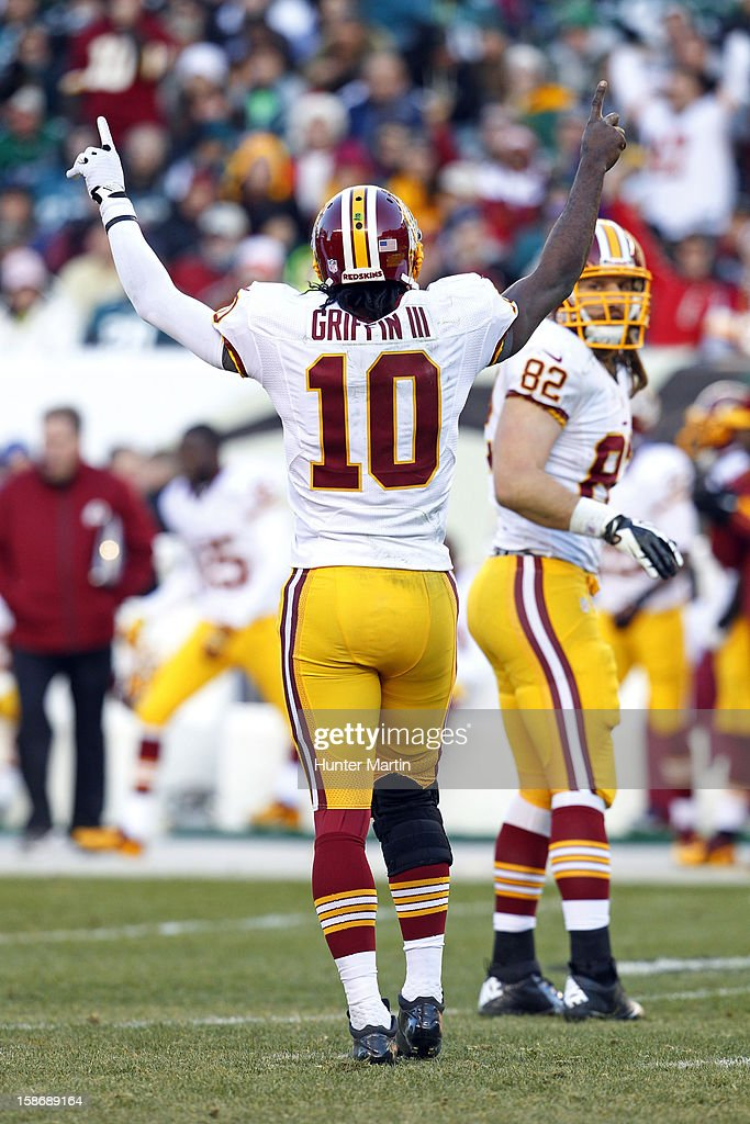 Quarterback <a gi-track='captionPersonalityLinkClicked' href=/galleries/search?phrase=Robert+Griffin&family=editorial&specificpeople=2495030 ng-click='$event.stopPropagation()'>Robert Griffin</a> III #10 of the Washington Redskins celebrates a third down conversion during a game against the Philadelphia Eagles on December 23, 2012 at Lincoln Financial Field in Philadelphia, Pennsylvania. The Redskins won 27-20.