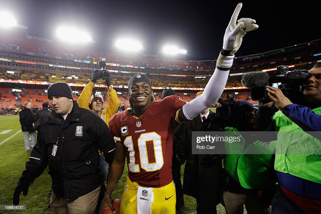 Quarterback <a gi-track='captionPersonalityLinkClicked' href=/galleries/search?phrase=Robert+Griffin&family=editorial&specificpeople=2495030 ng-click='$event.stopPropagation()'>Robert Griffin</a> III #10 of the Washington Redskins celebrates after the Redskins defeated the Dallas Cowboys 28-18 at FedExField on December 30, 2012 in Landover, Maryland.