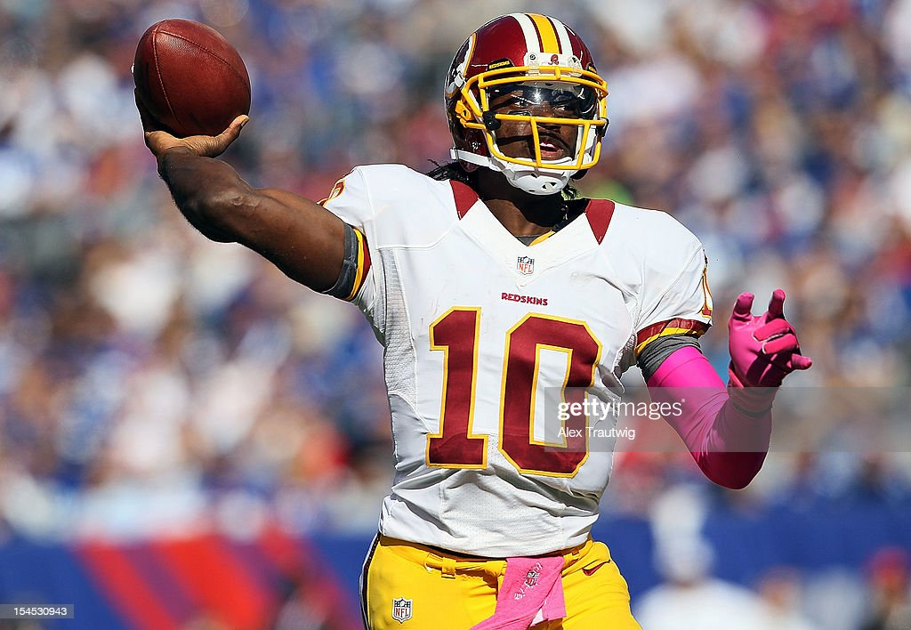 Quarterback <a gi-track='captionPersonalityLinkClicked' href=/galleries/search?phrase=Robert+Griffin&family=editorial&specificpeople=2495030 ng-click='$event.stopPropagation()'>Robert Griffin</a> III #10 of the Washington Redskins drops back to pass against the New York Giants during their game at MetLife Stadium on October 21, 2012 in East Rutherford, New Jersey.