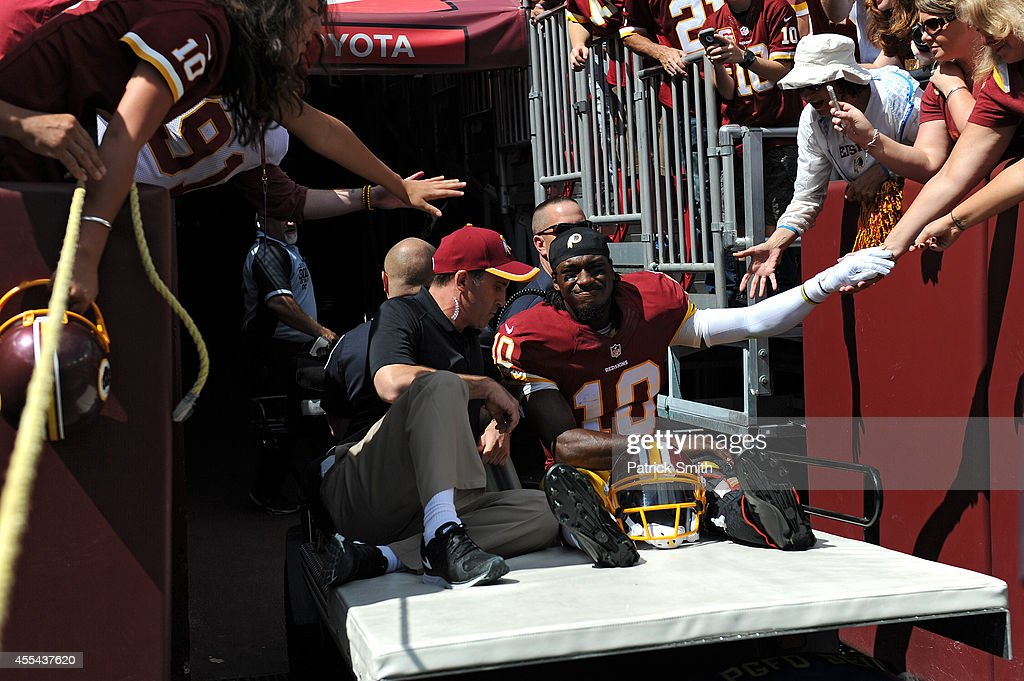 Quarterback <a gi-track='captionPersonalityLinkClicked' href=/galleries/search?phrase=Robert+Griffin&family=editorial&specificpeople=2495030 ng-click='$event.stopPropagation()'>Robert Griffin</a> III #10 of the Washington Redskins is carted off the field after being injured in the first quarter against the Jacksonville Jaguars at FedExField on September 14, 2014 in Landover, Maryland.