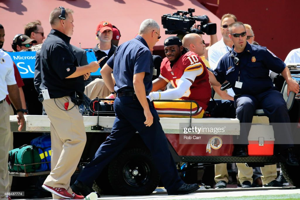 Quarterback <a gi-track='captionPersonalityLinkClicked' href=/galleries/search?phrase=Robert+Griffin&family=editorial&specificpeople=2495030 ng-click='$event.stopPropagation()'>Robert Griffin</a> III #10 of the Washington Redskins is carted off the field after being injured during a game against the Jacksonville Jaguars at FedExField on September 14, 2014 in Landover, Maryland.