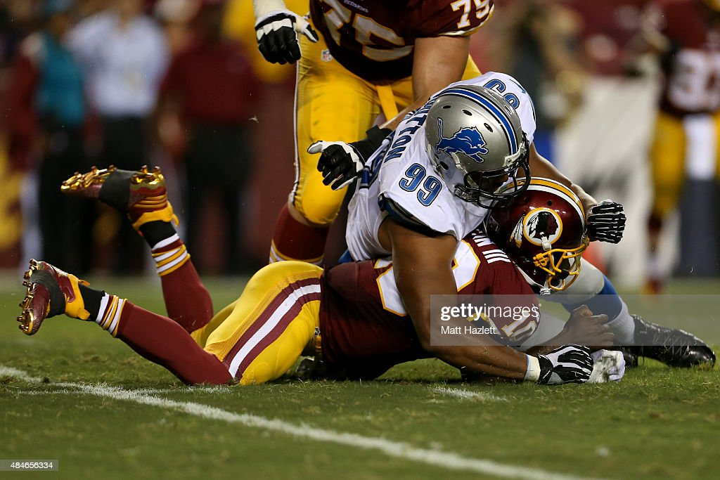 Quarterback Robert Griffin III #10 of the Washington Redskins is sacked by Corey Wootton #99 of the Detroit Lions during a preseason game at FedExField on August 20, 2015 in Landover, Maryland.