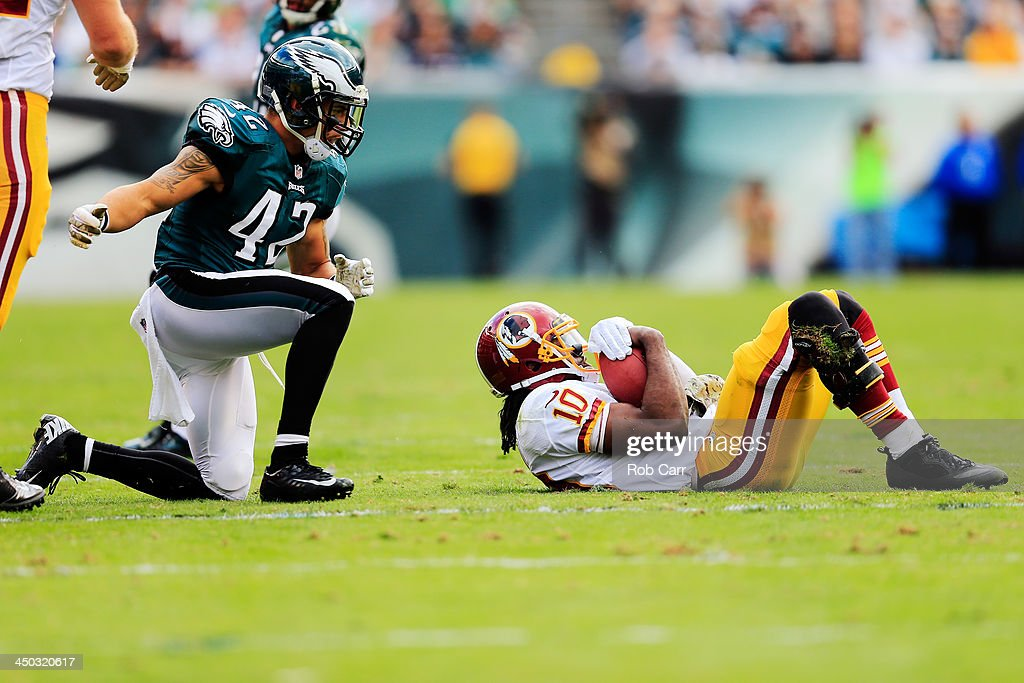 Quarterback <a gi-track='captionPersonalityLinkClicked' href=/galleries/search?phrase=Robert+Griffin&family=editorial&specificpeople=2495030 ng-click='$event.stopPropagation()'>Robert Griffin</a> III #10 of the Washington Redskins lays on the field after being tackled by free safety <a gi-track='captionPersonalityLinkClicked' href=/galleries/search?phrase=Kurt+Coleman+-+American+Football+Player&family=editorial&specificpeople=15191225 ng-click='$event.stopPropagation()'>Kurt Coleman</a> #42 of the Philadelphia Eagles at Lincoln Financial Field on November 17, 2013 in Philadelphia, Pennsylvania.
