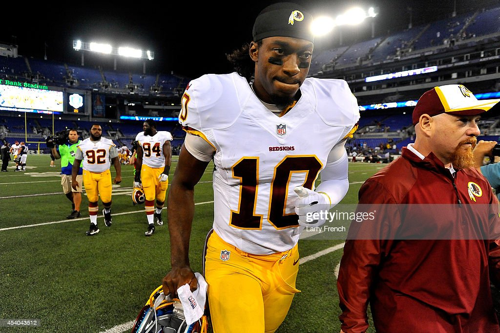 Quarterback Robert Griffin III #10 of the Washington Redskins leaves the field after a preseason game against the Baltimore Ravens at M&T Bank Stadium on August 23, 2014 in Baltimore, Maryland.