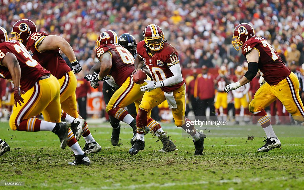 Quarterback Robert Griffin III #10 of the Washington Redskins looks to hand the ball off against the Baltimore Ravens during the second half at FedExField on December 9, 2012 in Landover, Maryland.