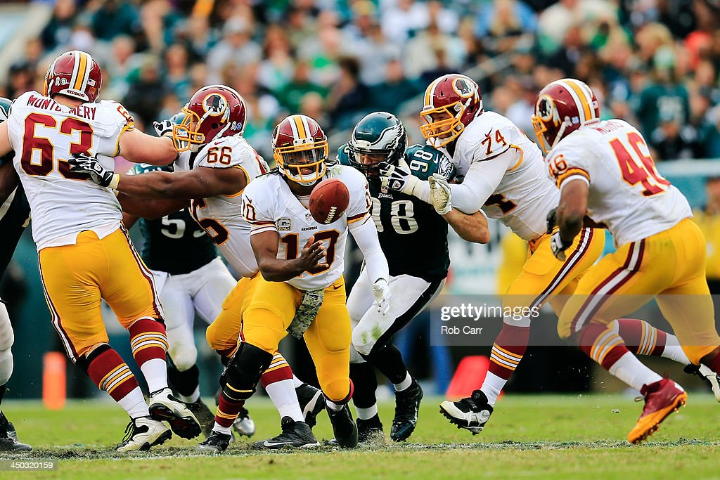 Quarterback <a gi-track='captionPersonalityLinkClicked' href=/galleries/search?phrase=Robert+Griffin&family=editorial&specificpeople=2495030 ng-click='$event.stopPropagation()'>Robert Griffin</a> III #10 of the Washington Redskins pitches the ball against the Philadelphia Eagles at Lincoln Financial Field on November 17, 2013 in Philadelphia, Pennsylvania.