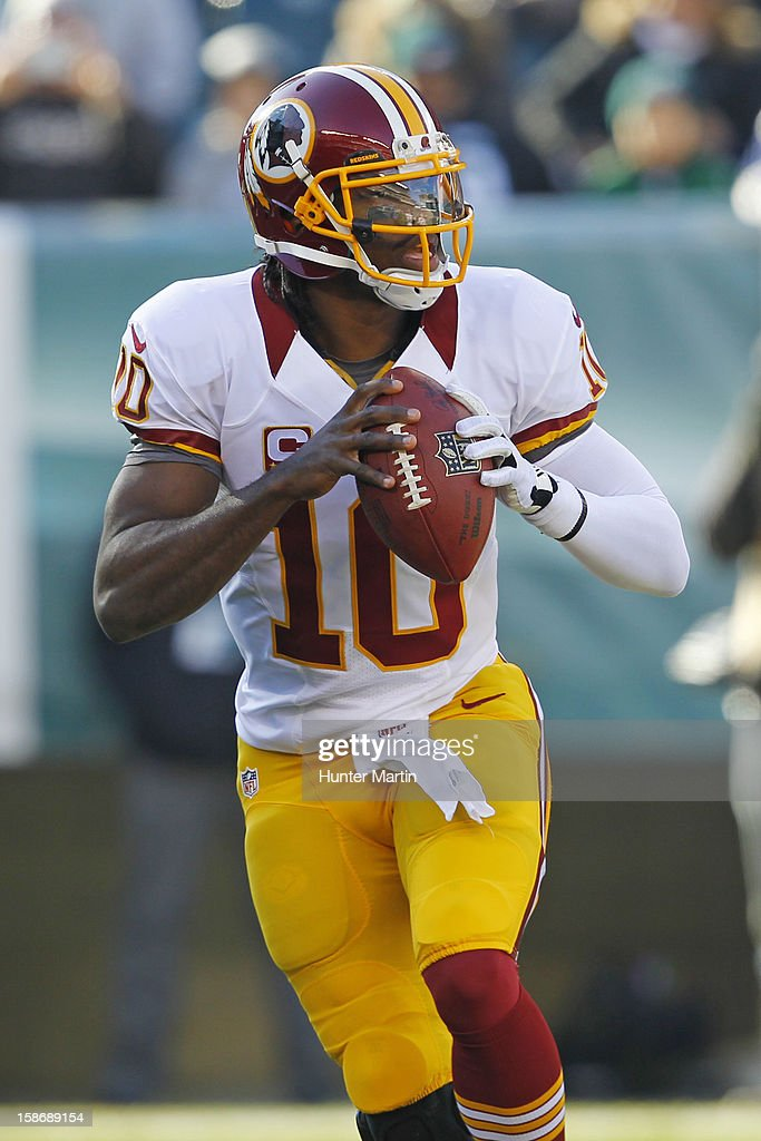 Quarterback <a gi-track='captionPersonalityLinkClicked' href=/galleries/search?phrase=Robert+Griffin&family=editorial&specificpeople=2495030 ng-click='$event.stopPropagation()'>Robert Griffin</a> III #10 of the Washington Redskins rolls out during a game against the Philadelphia Eagles on December 23, 2012 at Lincoln Financial Field in Philadelphia, Pennsylvania. The Redskins won 27-20.