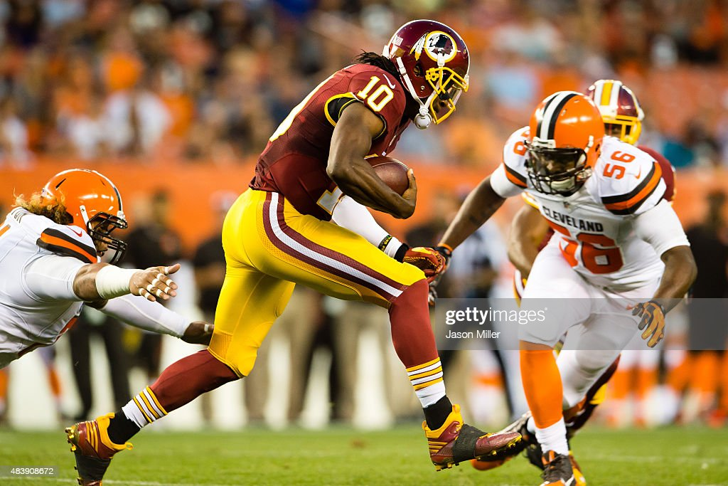 Quarterback Robert Griffin III #10 of the Washington Redskins runs for a gain before being tacked by inside linebacker Karlos Dansby #56 of the Cleveland Browns during the first half at FirstEnergy Stadium on August 13, 2015 in Cleveland, Ohio.