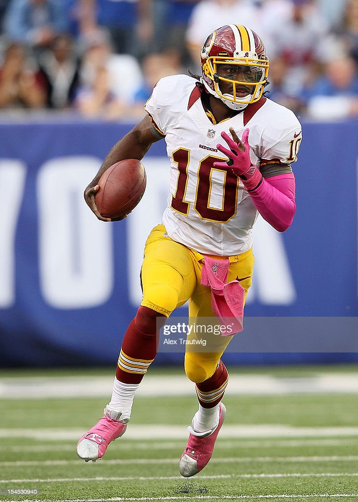 Quarterback <a gi-track='captionPersonalityLinkClicked' href=/galleries/search?phrase=Robert+Griffin&family=editorial&specificpeople=2495030 ng-click='$event.stopPropagation()'>Robert Griffin</a> III #10 of the Washington Redskins runs the ball against the New York Giants during their game at MetLife Stadium on October 21, 2012 in East Rutherford, New Jersey.