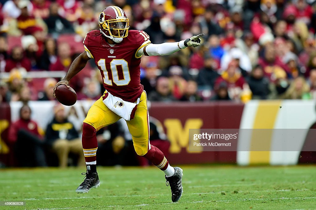 Quarterback Robert Griffin III of the Washington Redskins rushes in the second half of a game against the Tampa Bay Buccaneers at FedExField on...