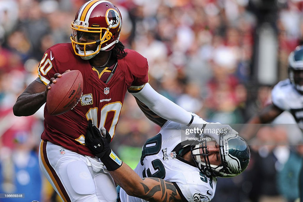 Quarterback <a gi-track='captionPersonalityLinkClicked' href=/galleries/search?phrase=Robert+Griffin&family=editorial&specificpeople=2495030 ng-click='$event.stopPropagation()'>Robert Griffin</a> III #10 of the Washington Redskins stiff arms defensive end <a gi-track='captionPersonalityLinkClicked' href=/galleries/search?phrase=Jason+Babin&family=editorial&specificpeople=220902 ng-click='$event.stopPropagation()'>Jason Babin</a> #93 of the Philadelphia Eagles in the second quarter at FedEx Field on November 18, 2012 in Landover, Maryland.