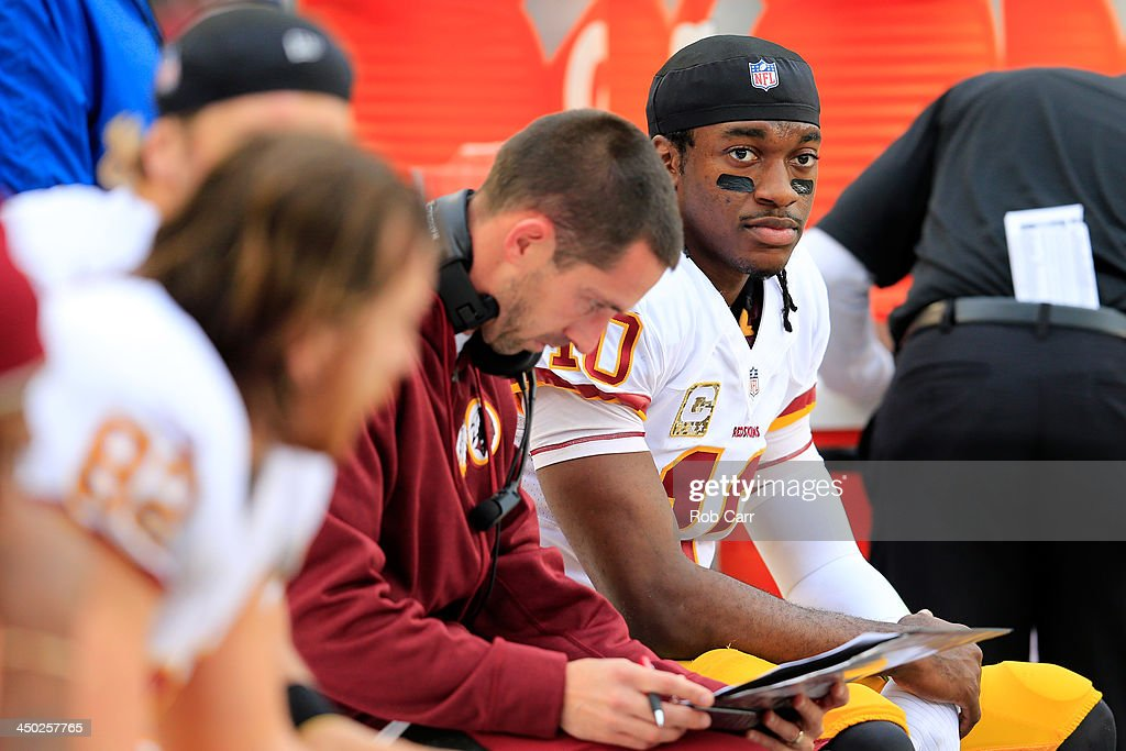 Quarterback Robert Griffin III #10 of the Washington Redskins talks with offensive coordinator Kyle Shanahan (L) during the first half against the Philadelphia Eagles at Lincoln Financial Field on November 17, 2013 in Philadelphia, Pennsylvania.