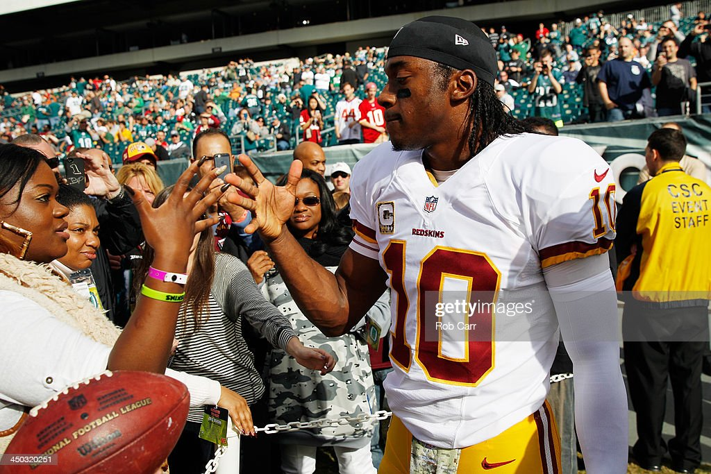 Quarterback <a gi-track='captionPersonalityLinkClicked' href=/galleries/search?phrase=Robert+Griffin&family=editorial&specificpeople=2495030 ng-click='$event.stopPropagation()'>Robert Griffin</a> III #10 of the Washington Redskins talks with fans before the start of the Redskins game against the Philadelphia Eagles at Lincoln Financial Field on November 17, 2013 in Philadelphia, Pennsylvania.