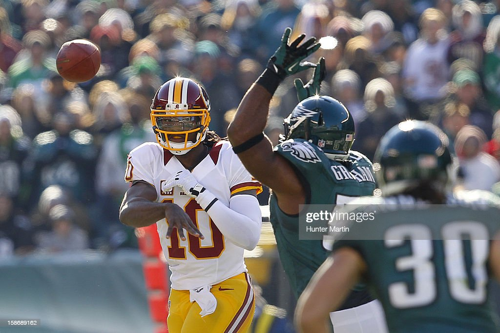 Quarterback <a gi-track='captionPersonalityLinkClicked' href=/galleries/search?phrase=Robert+Griffin&family=editorial&specificpeople=2495030 ng-click='$event.stopPropagation()'>Robert Griffin</a> III #10 of the Washington Redskins throws a pass during a game against the Philadelphia Eagles on December 23, 2012 at Lincoln Financial Field in Philadelphia, Pennsylvania. The Redskins won 27-20.