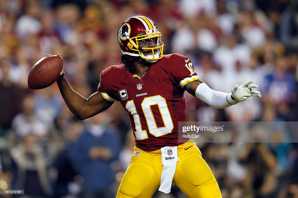 Quarterback <a gi-track='captionPersonalityLinkClicked' href=/galleries/search?phrase=Robert+Griffin&family=editorial&specificpeople=2495030 ng-click='$event.stopPropagation()'>Robert Griffin</a> III #10 of the Washington Redskins throws the ball in the first quarter while taking on the New York Giants at FedExField on December 3, 2012 in Landover, Maryland.