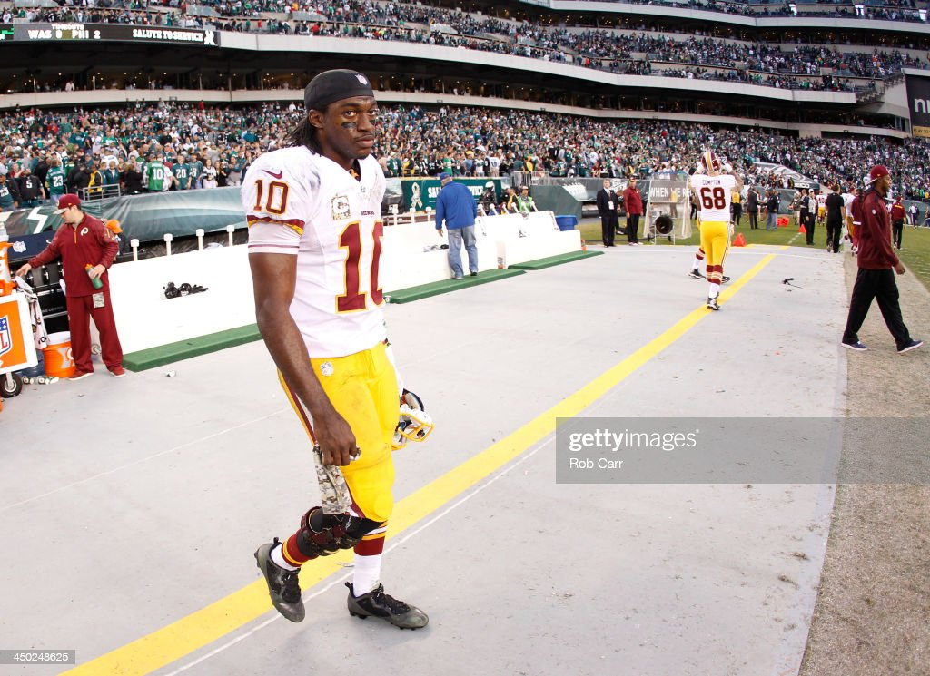 Quarterback <a gi-track='captionPersonalityLinkClicked' href=/galleries/search?phrase=Robert+Griffin&family=editorial&specificpeople=2495030 ng-click='$event.stopPropagation()'>Robert Griffin</a> III #10 of the Washington Redskins walks off the field following the Redskins 24-16 loss to the Philadelphia Eagles at Lincoln Financial Field on November 17, 2013 in Philadelphia, Pennsylvania.