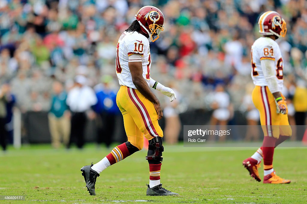 Quarterback <a gi-track='captionPersonalityLinkClicked' href=/galleries/search?phrase=Robert+Griffin&family=editorial&specificpeople=2495030 ng-click='$event.stopPropagation()'>Robert Griffin</a> III #10 of the Washington Redskins walks off the field against the Philadelphia Eagles at Lincoln Financial Field on November 17, 2013 in Philadelphia, Pennsylvania.