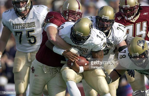 Quarterback Rod Rutherford of Pittsburgh gets tackled by Phillip Mettling of Boston College during Pittsburgh's 2413 victory over BC at Alumni...