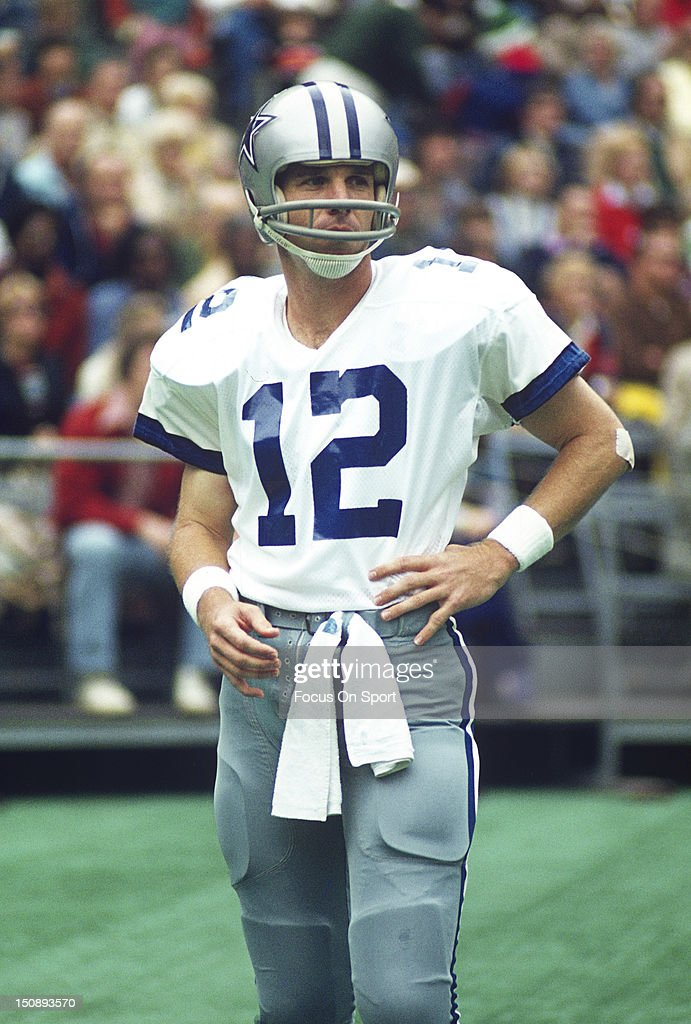 Quarterback <a gi-track='captionPersonalityLinkClicked' href=/galleries/search?phrase=Roger+Staubach&family=editorial&specificpeople=208812 ng-click='$event.stopPropagation()'>Roger Staubach</a> #12 of Dallas Cowboys looks on against the Philadelphia Eagles during an NFL football game at Veterans Stadium circa 1975 in Philadelphia, Pennsylvania. Staubach played for the Cowboys from 1969-79.