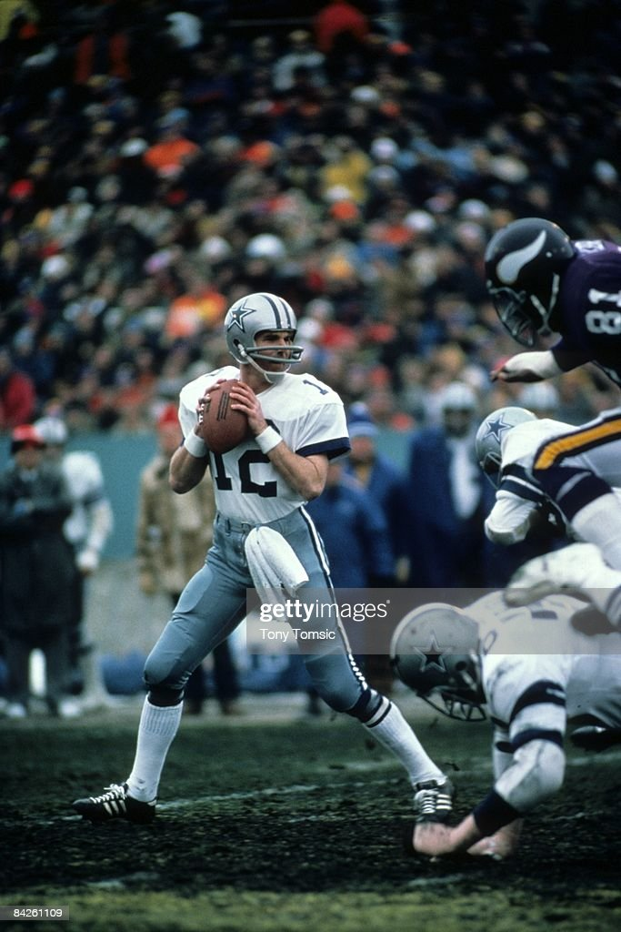 Quarterback Roger Staubach of the Dallas Cowboys drops back to pass during the NFC Divisional Playoff Game on December 28 1975 against the Minnesota...