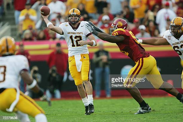 Quarterback Rudy Carpenter of the Arizona State Sun Devils throws under pressure from defensive tackle Chris Barrett of the USC Trojans at the Los...