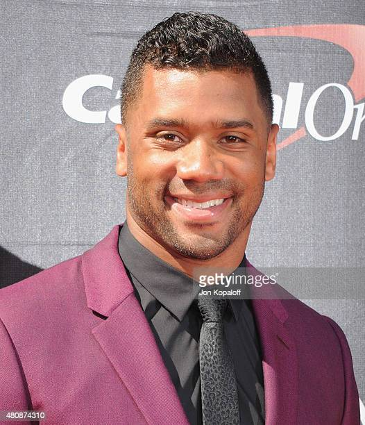 NFL quarterback Russell Wilson arrives at The 2015 ESPYS at Microsoft Theater on July 15 2015 in Los Angeles California