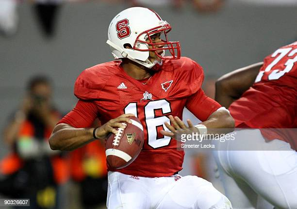 Quarterback Russell Wilson of the North Carolina State Wolfpack drops back to pass against the South Carolina Gamecocks during the game at...