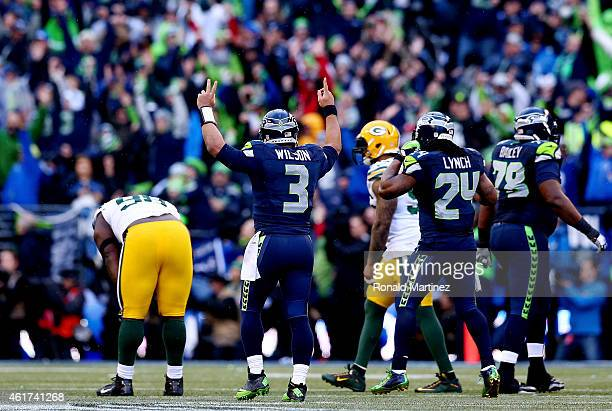 Quarterback Russell Wilson of the Seattle Seahawks celebrates after throwing the game winning touchdown pass to Jermaine Kearse in overtime to defeat...