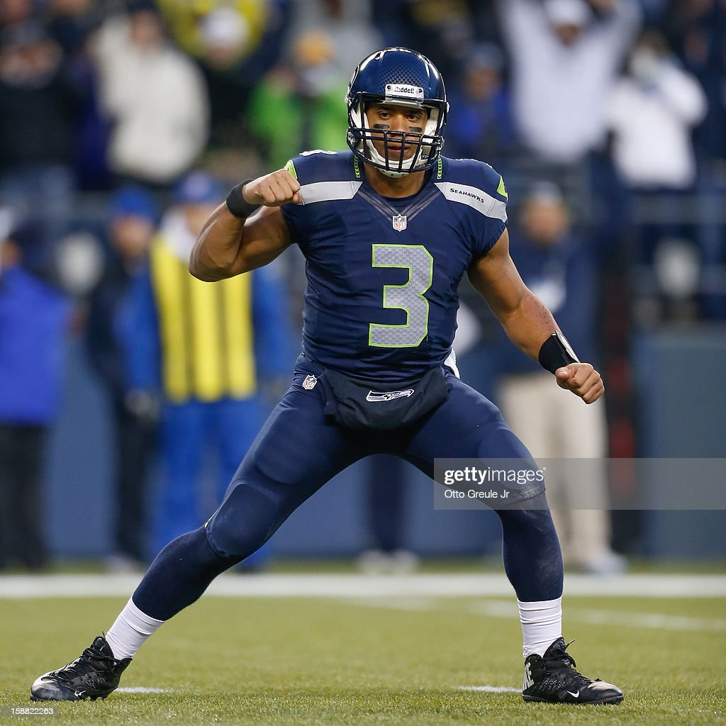 Quarterback Russell Wilson #3 of the Seattle Seahawks celebrates an apparent touchdown by running back Marshawn Lynch with under two minutes remaining against the St. Louis Rams at CenturyLink Field on December 30, 2012 in Seattle, Washington. The play was challenged and reversed, but the Seahawks defeated the Rams 20-13.