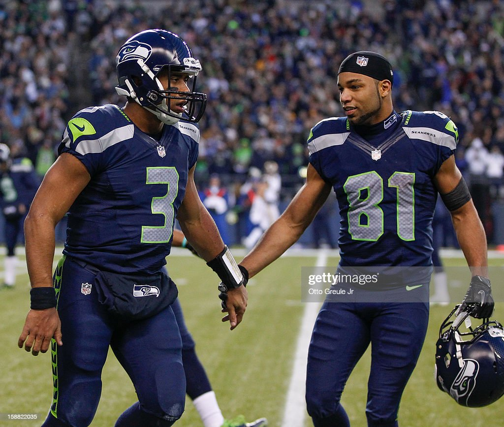 Quarterback Russell Wilson #3 of the Seattle Seahawks celebrates with wide receiver Golden Tate #81 after scoring a touchdown against the St. Louis Rams at CenturyLink Field on December 30, 2012 in Seattle, Washington. The Seahawks defeated the Rams 20-13.