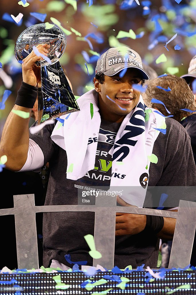 Quarterback <a gi-track='captionPersonalityLinkClicked' href=/galleries/search?phrase=Russell+Wilson+-+American+Football+Quarterback&family=editorial&specificpeople=2292912 ng-click='$event.stopPropagation()'>Russell Wilson</a> #3 of the Seattle Seahawks holds the Vince Lombardi Trophy after winning Super Bowl XLVIII at MetLife Stadium on February 2, 2014 in East Rutherford, New Jersey.The Seahawks beat the Broncos 43-8.