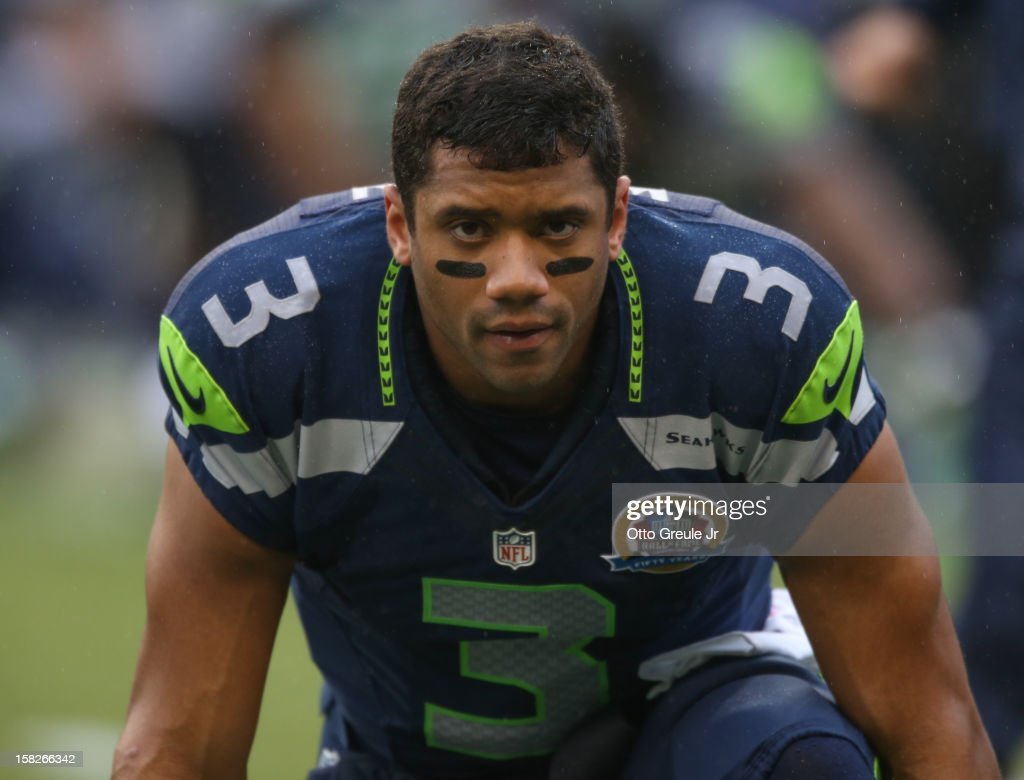 Quarterback <a gi-track='captionPersonalityLinkClicked' href=/galleries/search?phrase=Russell+Wilson+-+Joueur+de+football+am%C3%A9ricain+-+Quarterback&family=editorial&specificpeople=2292912 ng-click='$event.stopPropagation()'>Russell Wilson</a> #3 of the Seattle Seahawks looks on prior to the game against the Arizona Cardinals at CenturyLink Field on December 9, 2012 in Seattle, Washington.