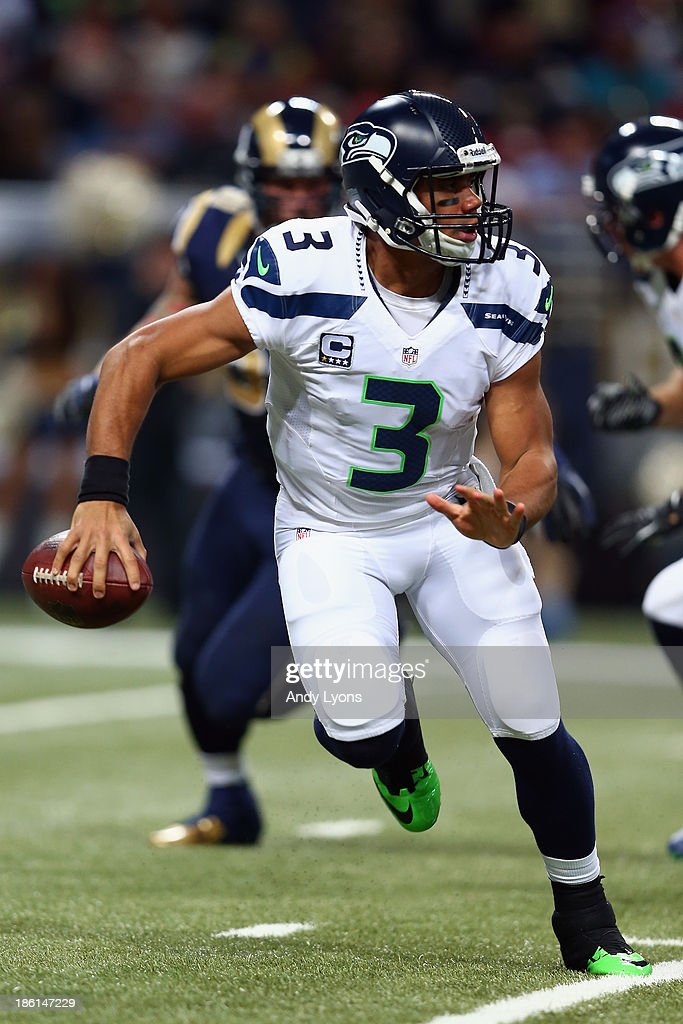 Quarterback Russell Wilson #3 of the Seattle Seahawks looks to pass against the St. Louis Rams during an NFL game at Edward Jones Dome on October 28, 2013 in St Louis, Missouri.