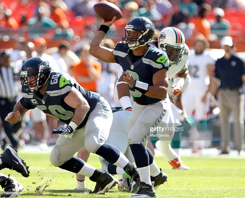 Quarterback Russell Wilson #3 of the Seattle Seahawks passes against the Miami Dolphins at Sun Life Stadium on November 25, 2012 in Miami Gardens, Florida.
