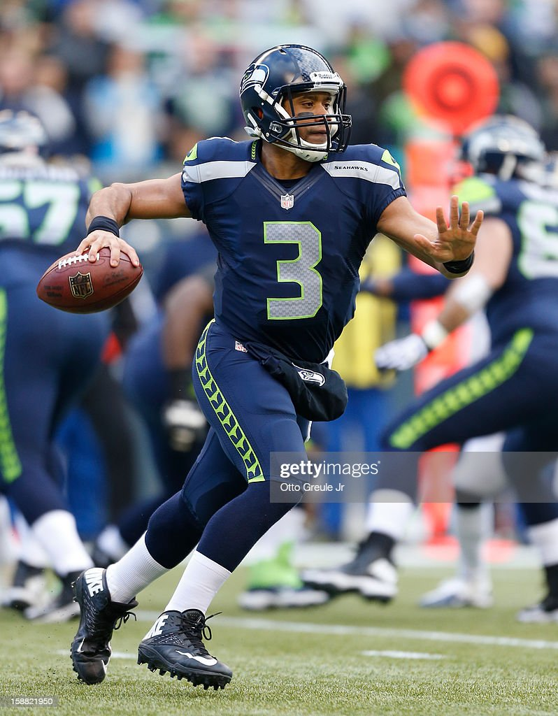 Quarterback Russell Wilson #3 of the Seattle Seahawks passes against the St. Louis Rams at CenturyLink Field on December 30, 2012 in Seattle, Washington. The Seahawks defeated the Rams 20-13.