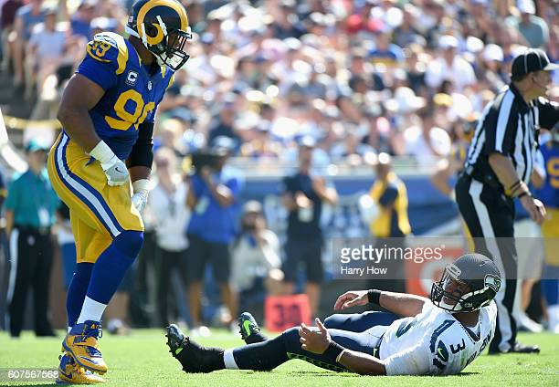 Quarterback Russell Wilson of the Seattle Seahawks reacts after being sacked by Aaron Donald of the Los Angeles Rams during the second quarter of the...