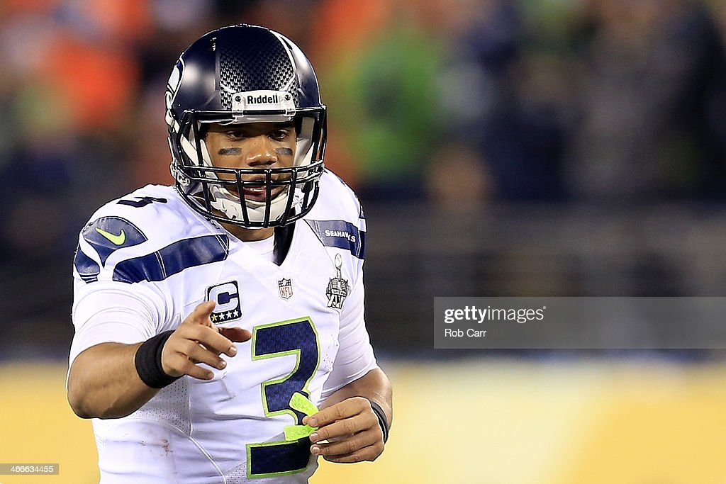 Quarterback <a gi-track='captionPersonalityLinkClicked' href=/galleries/search?phrase=Russell+Wilson+-+American+Football+Quarterback&family=editorial&specificpeople=2292912 ng-click='$event.stopPropagation()'>Russell Wilson</a> #3 of the Seattle Seahawks reacts in the first quarter against the Denver Broncos during Super Bowl XLVIII at MetLife Stadium on February 2, 2014 in East Rutherford, New Jersey.