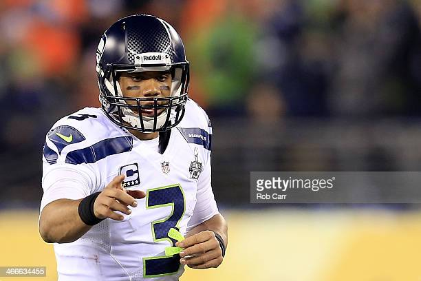 Quarterback Russell Wilson of the Seattle Seahawks reacts in the first quarter against the Denver Broncos during Super Bowl XLVIII at MetLife Stadium...