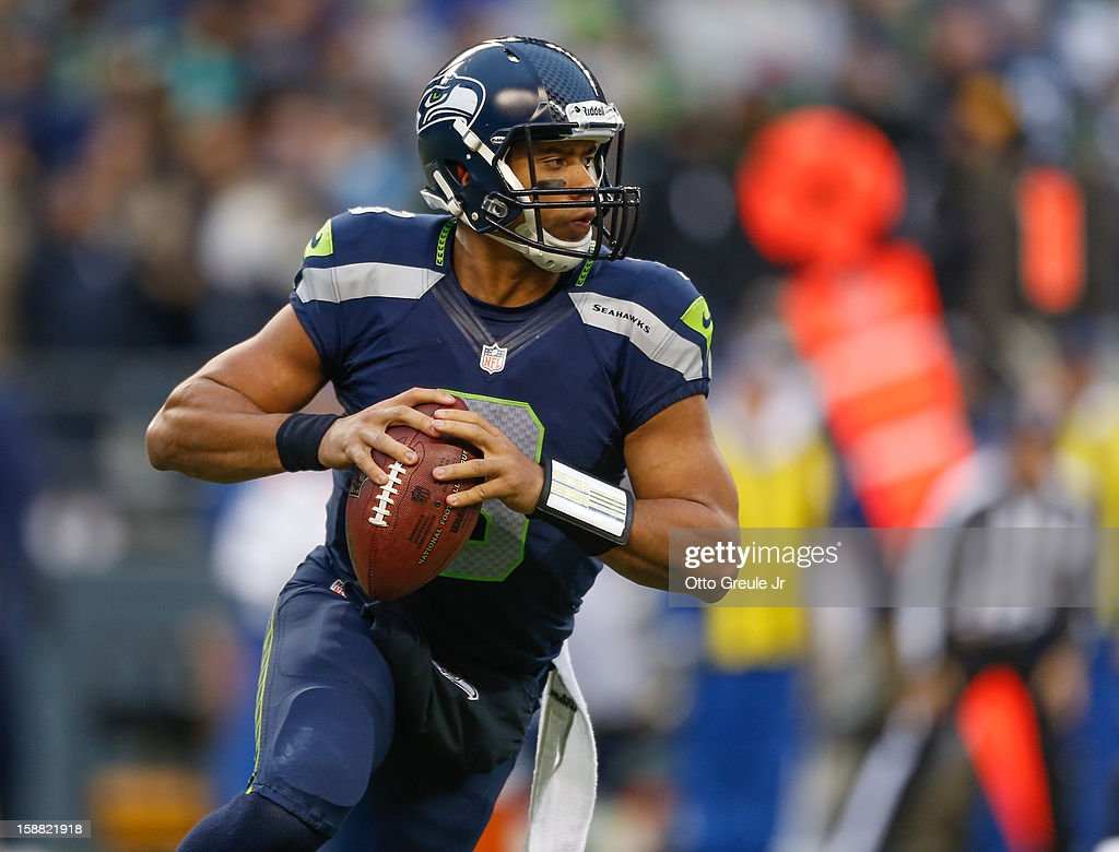 Quarterback Russell Wilson #3 of the Seattle Seahawks rolls out to pass against the St. Louis Rams at CenturyLink Field on December 30, 2012 in Seattle, Washington. The Seahawks defeated the Rams 20-13.