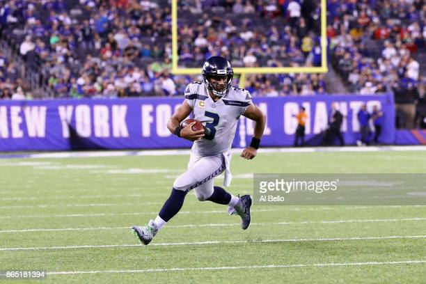 Quarterback Russell Wilson of the Seattle Seahawks runs the ball against the New York Giants during the fourth quarter of the game at MetLife Stadium...