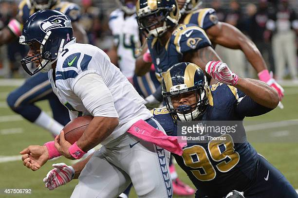 Quarterback Russell Wilson of the Seattle Seahawks runs with the ball against the St Louis Rams in the fourth quarter at the Edward Jones Dome on...