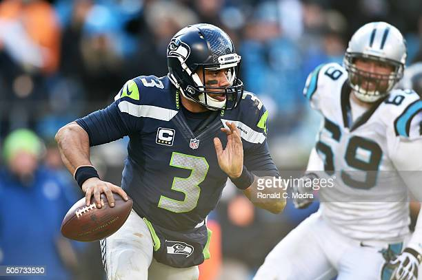 Quarterback Russell Wilson of the Seattle Seahawks scrambles during the NFC Divisional Playoff Game against the Carolina Panthers at Bank of America...