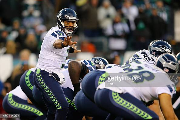 Quarterback Russell Wilson of the Seattle Seahawks talks at the line of scrimmage during the first quarter against the Philadelphia Eagles at Lincoln...